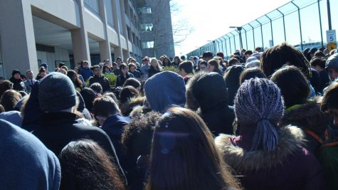 UNIS community having moments of silence during the school walkout. Photo taken by Workneh Getasew.