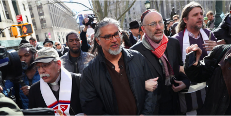Protesters accompany prominent immigration activist Ravi Ragbir, outside the U.S. Immigration and Customs Enforcement office at the U.S. Federal Building during a Solidarity Rally Against Deportation on March 9, 2017, in New York City.