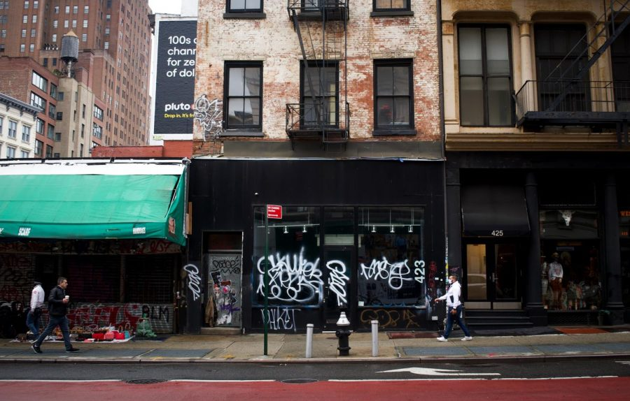 Graffitied storefront on a main street.