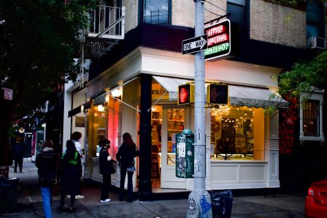 "Little Cupcake Bakeshop had a few customers, cupcakes, and a Food & Wine Magazine proclaiming it has ""best chocolate cake in the US."""